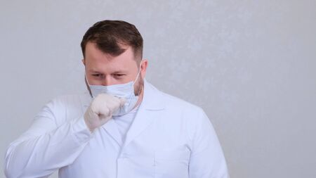 Doctor coughs in a protective mask infected with a virus or coronavirus