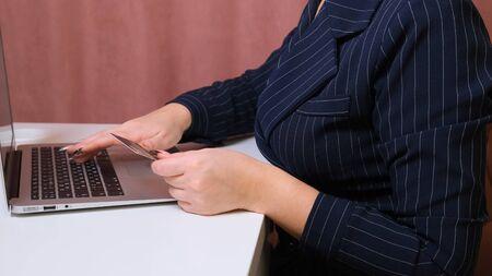 woman makes bargains through the internet, close-up