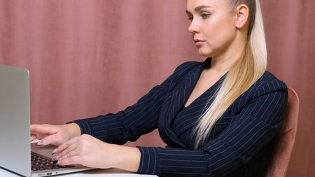 woman working laptop. Business woman busy working on laptop computer at office.