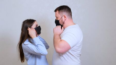 female and male look at each other in protective masks and hug. Hygiene concept. prevent the spread of germs and bacteria and avoid infection with the crown virus. 스톡 콘텐츠