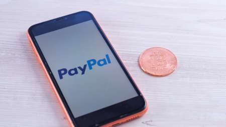 PayPal logo on the screen smartphone with bitcoin cryptocurrency: Moscow, Russia - May 31, 2021.