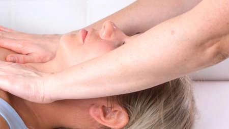 Beautiful woman getting neckline massage in beauty salon Imagens