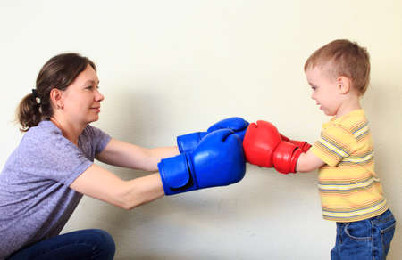 boxing match: Boxing match. mother and son in a Boxing match Stock Photo