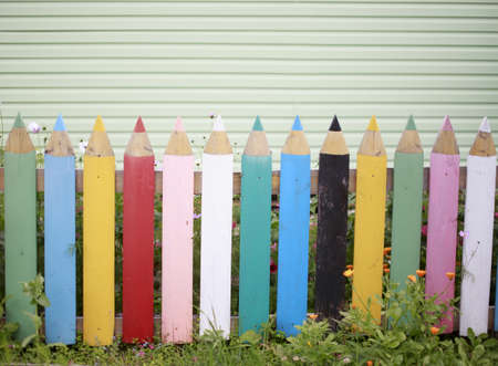 tinkering: fence of colored pencils. the fence in the garden of multi-colored planks in the form of pencils