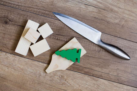 symbolize: deforestation. knife and cutting Board with a figure of the tree symbolize the destruction of forests Stock Photo