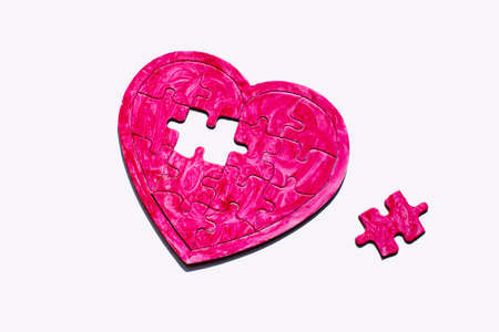 disadvantages: heart puzzle. picture of a heart with a missing piece of the puzzle, the symbol of love searches Stock Photo