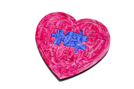 homosexual love. Red heart puzzle with blue details symbolizes love homosexual couples Stok Fotoğraf