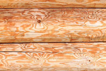 building feature: wood texture. Texture of peeled logs in the wall of the house Stock Photo