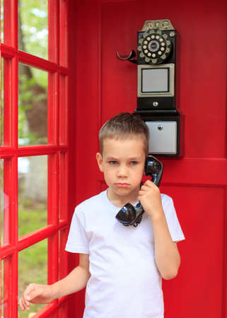 payphone: resentment by phone. boy mad at his interlocutor on the phone