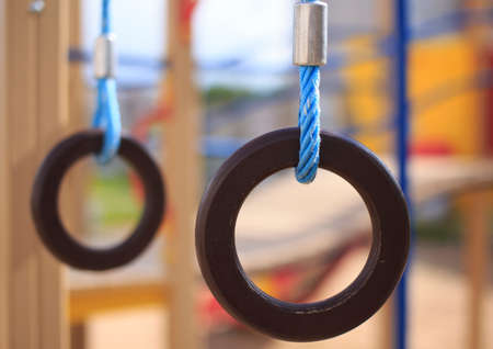 Gymnastic rings. gymnastic rings on kids playground Stock Photo