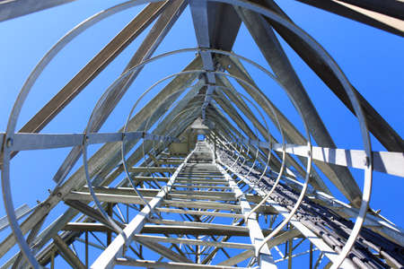 stairs to tower. ladder on telecommunications tower Banco de Imagens - 45883812