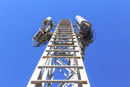 ladder on telecommunications tower. ladder on telecommunications tower with the attached transceiver antennas of cellular communication