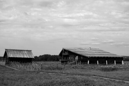 Nature. Summer day in the village. Wooden houses. Black and white Imagens