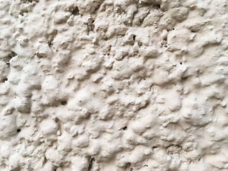 Wall texture covered with white paint. White background.