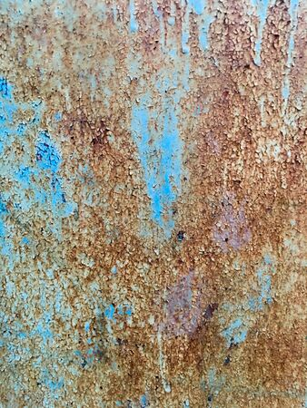 Iron wall with old blue paint in the crack. Abstract grunge background. Stock Photo