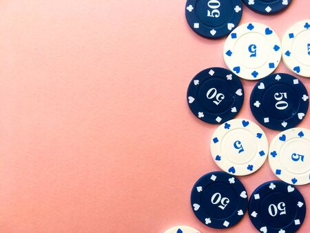 Chips for poker on pink background. Poker play. Copy space. Banco de Imagens