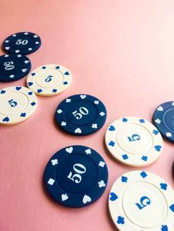 Chips for poker on pink background. Gambling. Poker play. Copy space.