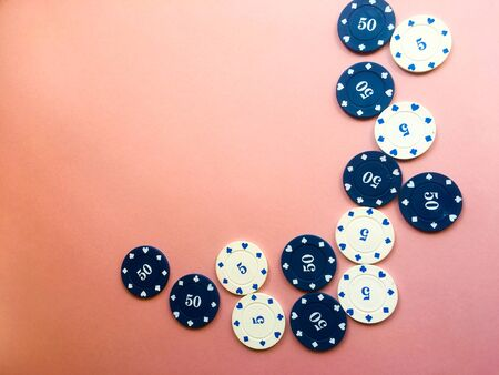 Chips for poker on pink background. Five and fifty chips. Poker play. Copy space. 写真素材 - 130120365