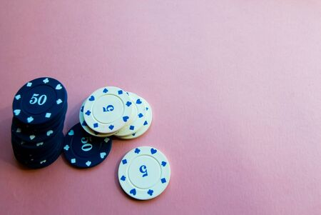 Chips for poker on pink background. Poker play. Copy space. Stok Fotoğraf