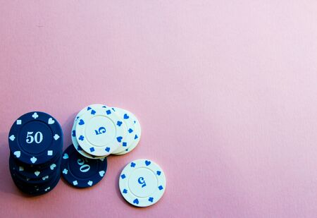 Chips for poker on pink background. Poker play. Place for text.