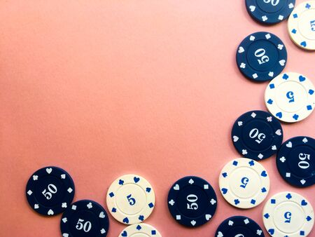 Chips for poker on pink background. Poker play. Copy space.