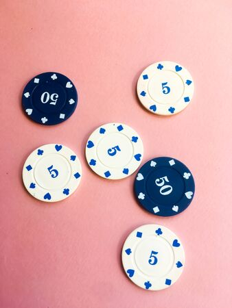 Chips for poker on pink background. Poker play. Five and fifty chips. 写真素材 - 130119992