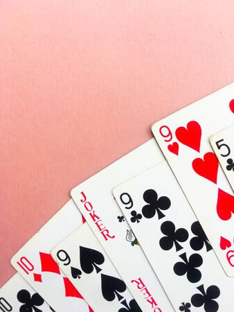 Cards for poker on orange background. Poker play. Place for text.