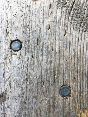 Old wooden board with nails. Wood texture. Close-up.