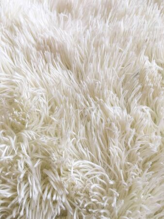 The texture of natural fluffy soft fabric. Close-up. Background for design and creativity.