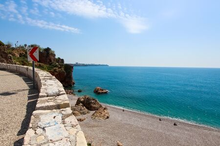 Tourist beach of the Mediterranean Sea. Sunny day. Antalya, Turkey, April 6 2019 写真素材