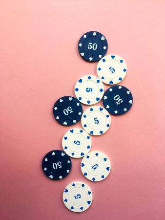 Poker chips on a pink background. Place for text. Gambling.