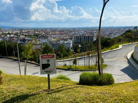 View of the city and the road from the hill. Ahead of the plate: danger. Travel route. Turkey. Autumn. November 12th 2019. Stock Photo