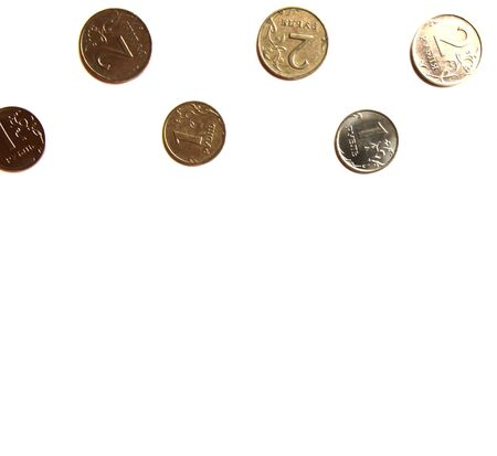 Several Russian coins lie on a white isolated background at the top. Place for text.