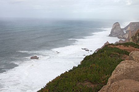 roca: A place where the sea meets the land. High cliffs. Big waves and gusty winds. Cabo da Roca Stock Photo