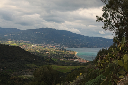 Amazing mountain landscape. Cloudy day. View from sightseeing area near Sanctuary of the Madonna di Tindari. Tindari. Sicily.