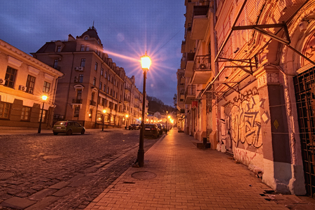 A morning view of colourful buildings on empty Andriyivskyy Uzvoz (Descent). Stock Photo