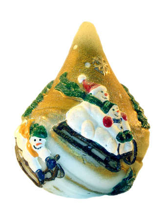 going for it: On a souvenir are represented the snowmans which are going for a drive on sledge . It is isolated on a white background.