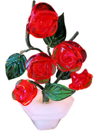 The figurine from a glass represents a bush of red roses. It is isolated on a white background. photo