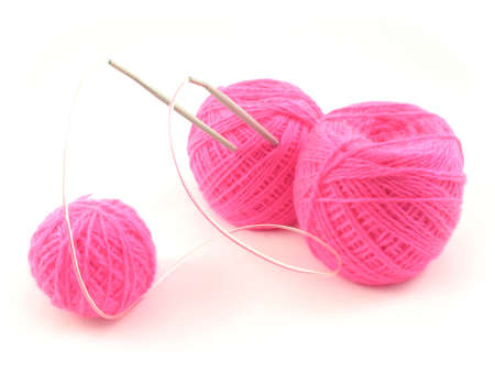 Three balls of pink threads and knitting spokes. It is isolated on a white background. Stock Photo - 5185127