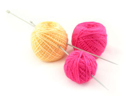 Three balls of pink and yellow threads and knitting spokes. It is isolated on a white background. Stock Photo - 5357018