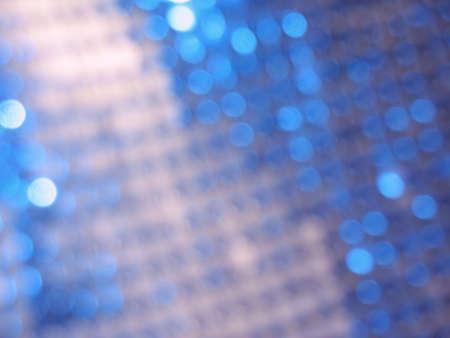Fondo abstracto con parches de círculos azules de la luz.  Foto de archivo