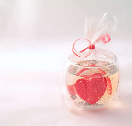 Gel candle with hearts and bubbles on a light background. Stock Photo - 6330128