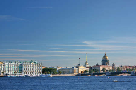 Saint-Petersburg. View of the Palace quay (Winter Palace - Hermitage, Admiralty, St. Isaacs Cathedral, Palace Bridge, Neva). Weather sunny. photo