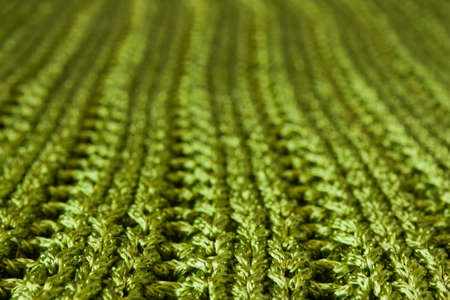villi: Sparkling green knit macro, its upper part out of focus. Stock Photo
