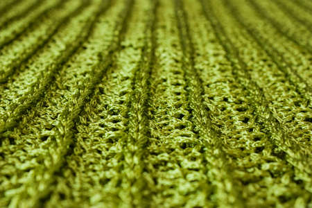villi: Sparkling green knit macro, focus on the central part of it. Stock Photo