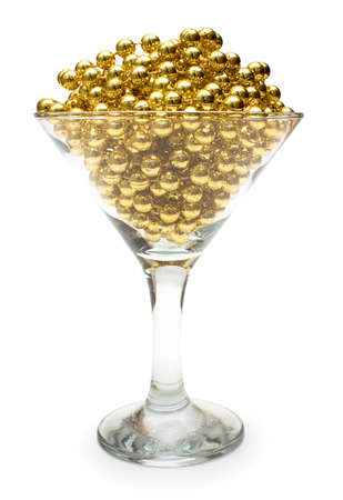 gewgaw: Goblet of gold  Necklace of gold beads in glass, isolated on white