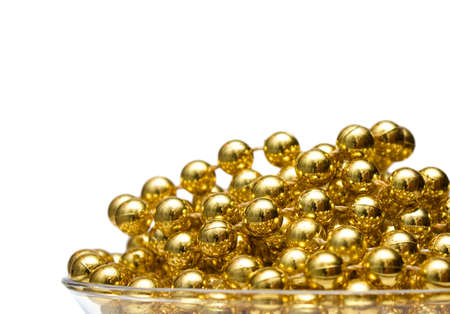 gewgaw: Luxury background with gold beads macro, isolated on white