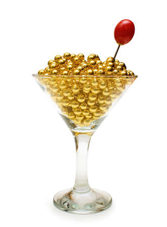 gewgaw: Concept of luxury martini  gold beads in glass with red olive Stock Photo