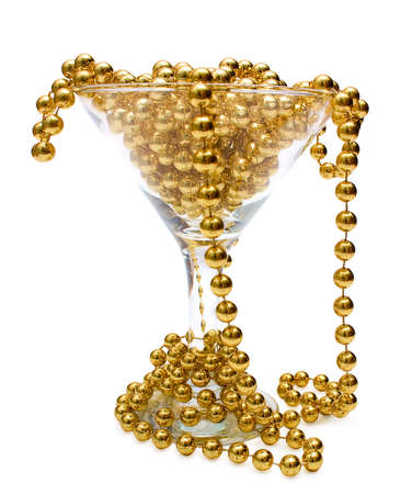 gewgaw: Goblet of gold  Necklace of gold beads in glass and around it, isolated on white