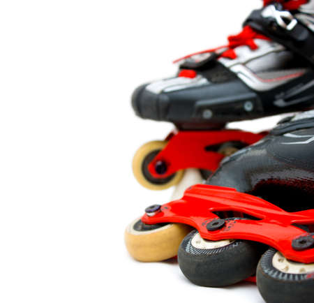 inline skates: Inline roller skates close up isolated on white background with blur  Vertical copy-space